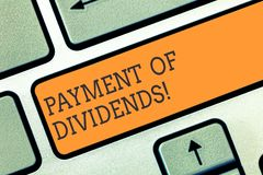 Conceptual hand writing showing Payment Of Dividends. Business photo showcasing Distribution of profits by the company. To shareholders Keyboard key Intention stock images
