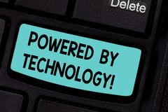 Conceptual hand writing showing Powered By Technology. Business photo showcasing Breakthrough led to the broad. Commercialization Keyboard key Intention to royalty free stock images