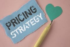 Conceptual hand writing showing Pricing Strategy. Business photo showcasing Marketing sales strategies profit promotion campaign w. Ritten Tear Note paper Pink Stock Photos