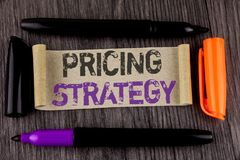 Conceptual hand writing showing Pricing Strategy. Business photo text Marketing sales strategies profit promotion campaign written. Cardboard Paper the wooden Stock Photos