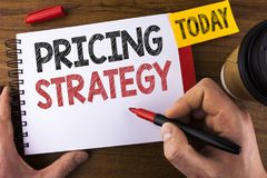 Conceptual hand writing showing Pricing Strategy. Business photo text Marketing sales strategies profit promotion campaign written. By Man Notepad holding Pen Stock Images