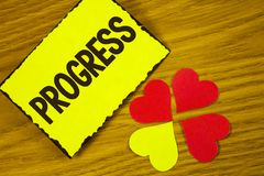 Conceptual hand writing showing Progress. Business photo text Depelopment Growth Process of improvement to achieve a goal written. Sticky note paper wooden Stock Photo