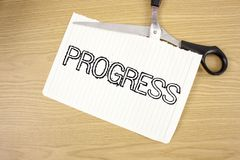 Conceptual hand writing showing Progress. Business photo text Depelopment Growth Process of improvement to achieve a goal written. Tear Notebook Paper wooden Stock Photo