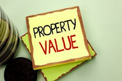 Conceptual hand writing showing Property Value. Business photo s. Howcasing Estimate of Worth Real Estate Residential Valuation written Sticky Note Paper the royalty free stock images