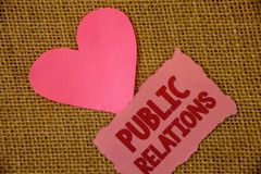 Conceptual hand writing showing Public Relations. Business photo text Communication Media People Information Publicity Social Text. Pink torn paper note heart stock photography