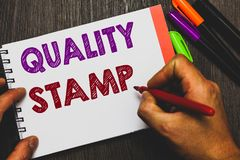 Conceptual hand writing showing Quality Stamp. Business photo text Seal of Approval Good Impression Qualified Passed Inspection Ma. N holding notebook paper stock photos