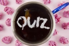 Conceptual hand writing showing Quiz. Business photo showcasing Short Tests Evaluation Examination to quantify your knowledge writ. Ten Tea in Cup within Paper Royalty Free Stock Photos