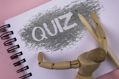 Conceptual hand writing showing Quiz. Business photo showcasing Short Tests Evaluation Examination to quantify your knowledge writ. Ten Notepad plain background Royalty Free Stock Photos