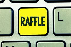 Conceptual hand writing showing Raffle. Business photo text means of raising money by selling numbered tickets offer as. Prize royalty free stock photography