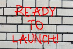 Conceptual hand writing showing Ready To Launch. Business photo text Prepared to start promote new product software. Application Brick Wall art like Graffiti royalty free stock photos