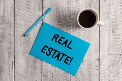 Conceptual hand writing showing Real Estate. Business photo showcasing owning property consisting of empty land or. Conceptual hand writing showing Real Estate stock image