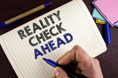 Conceptual hand writing showing Reality Check Ahead. Business photo showcasing Unveil truth knowing actuality avoid being sceptica. L written by Man Notebook stock image