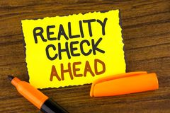 Conceptual hand writing showing Reality Check Ahead. Business photo showcasing Unveil truth knowing actuality avoid being sceptica. L written Yellow Sticky note Royalty Free Stock Photo