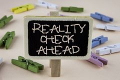 Conceptual hand writing showing Reality Check Ahead. Business photo showcasing Unveil truth knowing actuality avoid being sceptica. L written Wooden Notice Board Stock Photos