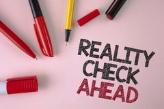 Conceptual hand writing showing Reality Check Ahead. Business photo text Unveil truth knowing actuality avoid being sceptical writ. Ten plain Pink background stock photo