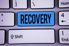 Conceptual hand writing showing Recovery. Business photo showcasing Return to normal state of health Regain possession or control. Written Key Button Keyboard Stock Image