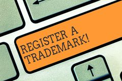 Conceptual hand writing showing Register A Trademark. Business photo showcasing To record or list as official company. Brand or logo Keyboard key Intention to stock photo