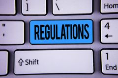 Conceptual hand writing showing Regulations. Business photo showcasing Rules Laws Corporate Standards Policies Security Statements. Written Key Button Keyboard Stock Image