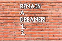 Conceptual hand writing showing Remain A Dreamer. Business photo showcasing they spend lot of time thinking about and. Conceptual hand writing showing Remain A royalty free stock images
