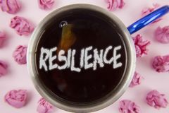 Conceptual hand writing showing Resilience. Business photo showcasing Capacity to recover quickly from difficulties Persistence wr. Itten Tea in Cup within Paper Royalty Free Stock Photos