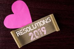 Conceptual hand writing showing Resolutions 2019. Business photo showcasing Positive reinforcement personal improvent corporate go. Als written Folded Cardboard Royalty Free Stock Photo