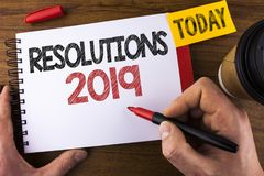 Conceptual hand writing showing Resolutions 2019. Business photo text Positive reinforcement personal improvent corporate goals wr. Itten by Man Notepad holding Royalty Free Stock Photos