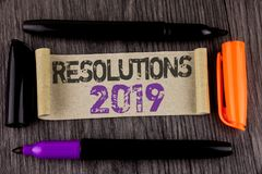 Conceptual hand writing showing Resolutions 2019. Business photo text Positive reinforcement personal improvent corporate goals wr. Itten Cardboard Paper the Stock Photography