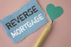Conceptual hand writing showing Reverse Mortgage. Business photo showcasing Elderly homeowner retirement option regular payment be. Nefit written Tear Note paper Stock Image