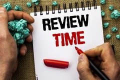 Conceptual hand writing showing Review Time. Business photo text Evaluating Survey Reviewing Analysis Checkup Inspection Revision. Written by Man Holding Marker Royalty Free Stock Photography