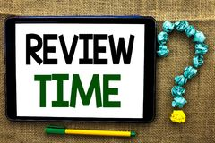 Conceptual hand writing showing Review Time. Business photo text Evaluating Survey Reviewing Analysis Checkup Inspection Revision. Written Tablet the jute Royalty Free Stock Images
