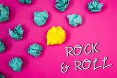 Conceptual hand writing showing Rock and Roll. Business photos showcasing Musical Genre Type of popular dance music Heavy Beat Sou. Conceptual hand writing royalty free stock photography