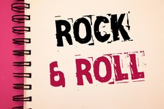 Conceptual hand writing showing Rock and Roll. Business photos showcasing Musical Genre Type of popular dance music Heavy Beat Sou. Conceptual hand writing royalty free stock photos