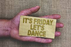 Conceptual hand writing showing It s is Friday Let s is Dance. Business photo showcasing Celebrate starting the weekend Go party D. Isco Music Thick gray paper royalty free stock images