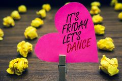 Conceptual hand writing showing It s is Friday Let s is Dance. Business photo text Celebrate starting the weekend Go party Disco M. Usic Paperclip hold pink royalty free stock photography