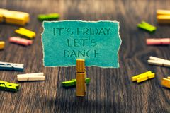 Conceptual hand writing showing It s is Friday Let s is Dance. Business photo showcasing Celebrate starting the weekend Go party D. Isco Music Paperclip blue royalty free stock photo