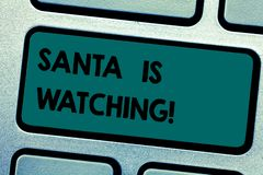 Conceptual hand writing showing Santa Is Watching. Business photo showcasing deliver presents like toys to all well royalty free stock photo