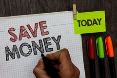 Conceptual hand writing showing Save Money. Business photo text store some of your cash every month to use them sometime later Man. Holding marker notebook stock photo