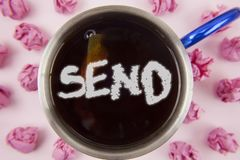 Conceptual hand writing showing Send. Business photo showcasing Arrange something to be delivered Mail a thing Deliver a message w. Ritten Tea in Cup within Stock Image
