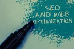Conceptual hand writing showing Seo And Web Optimization. Business photo showcasing Search Engine Keywording Marketing. Strategies Sprinkle blue color on floor royalty free stock photo