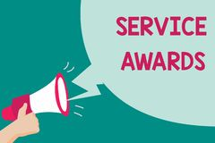 Conceptual hand writing showing Service Awards. Business photo text Recognizing an employee for his or her longevity or tenure royalty free stock images