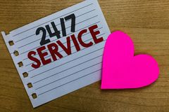 Conceptual hand writing showing 24 7 Service. Business photo showcasing Always available to serve Runs constantly without disrupti. On Notebook paper Romantic royalty free stock images