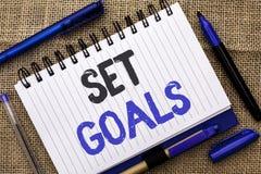 Conceptual hand writing showing Set Goals. Business photo showcasing Target Planning Vision Dreams Goal Idea Aim Target Motivation. Written Notebook Book jute Stock Image