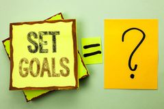 Conceptual hand writing showing Set Goals. Business photo showcasing Target Planning Vision Dreams Goal Idea Aim Target Motivation. Written Yellow Sticky Note Stock Images