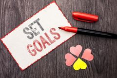 Conceptual hand writing showing Set Goals. Business photo text Target Planning Vision Dreams Goal Idea Aim Target Motivation writt. En Cardboard Piece With Stock Images