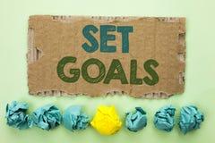 Conceptual hand writing showing Set Goals. Business photo text Target Planning Vision Dreams Goal Idea Aim Target Motivation writt. En Tear Cardboard plain Royalty Free Stock Photos