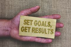 Conceptual hand writing showing Set Goals, Get Results. Business photo showcasing Establish objectives work for accomplish them Th. Ick gray paper with words stock photos