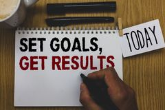 Conceptual hand writing showing Set Goals, Get Results. Business photo text Establish objectives work for accomplish them Written. On paper hand hold pen stock image