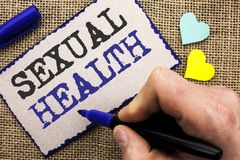 Conceptual hand writing showing Sexual Health. Business photo showcasing STD prevention Use Protection Healthy Habits Sex Care wri. Tten Sticky Note the jute stock image