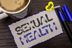 Conceptual hand writing showing Sexual Health. Business photo showcasing STD prevention Use Protection Healthy Habits Sex Care wri. Tten Sticky Note wooden royalty free stock images