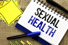 Conceptual hand writing showing Sexual Health. Business photo showcasing STD prevention Use Protection Healthy Habits Sex Care wri. Tten Notebook Book the jute stock image